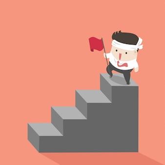 Biznesmen na najwyższych schodach.