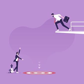 Biznesmen na platformie nurkowej patrzący w dół na cel z liderem pomagającym osiągnąć punkt docelowy