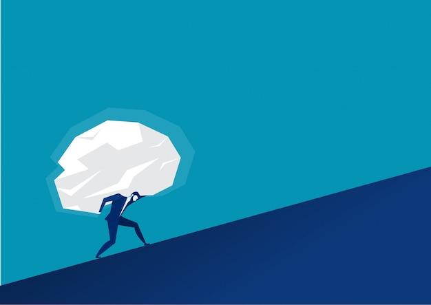 Biznesmen niesie ogromne kamienie naprzód sukces