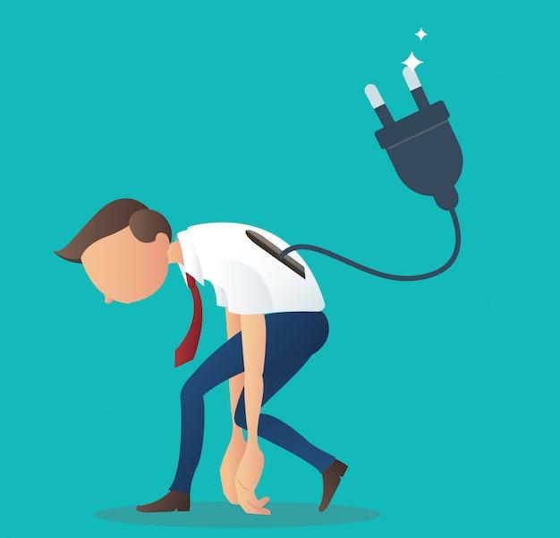 Biznesmen niskiego poziomu baterii z wtyczką elektryczną