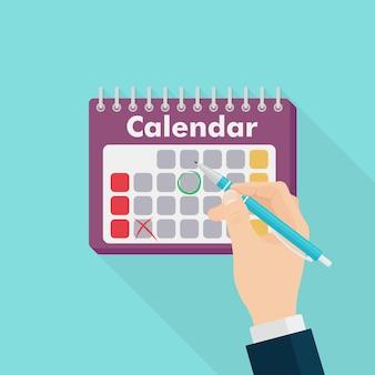 Biznesmen oznakowanie jeden dzień w kalendarzu. człowiek pisze piórem