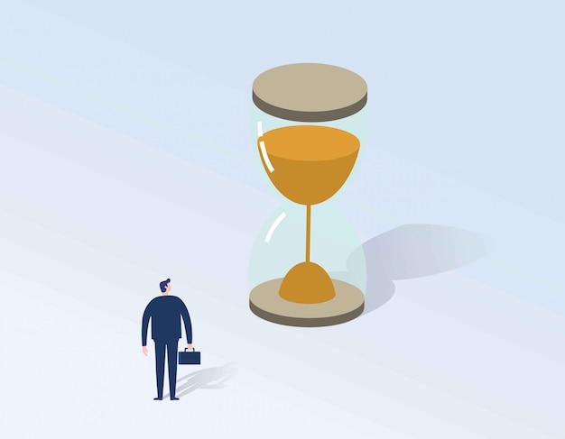 Biznesmen patrzeje hourglass