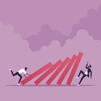 Biznesmen pchający domino do upadku innego biznesmena