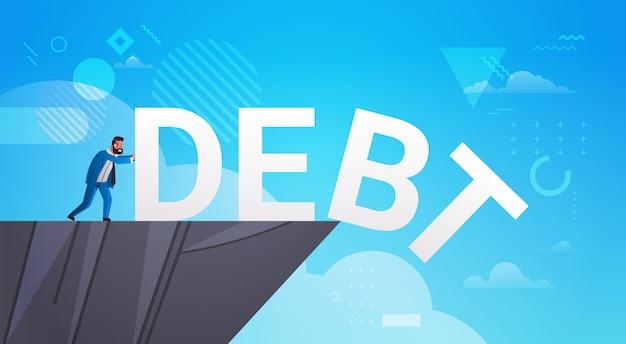 Biznesmen pchanie długu w otchłani wolności finanse pojęcie kryzysu koncepcja poziomej pełnej długości