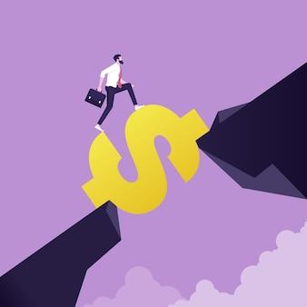 Biznesmen posługujący się znakiem dolara, aby przekroczyć lukę między wzgórzem ryzyko biznesowe a sukces