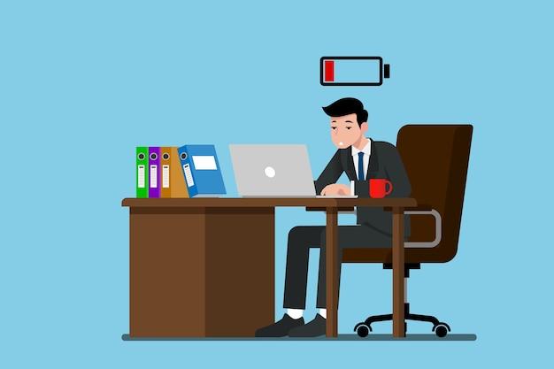 Biznesmen pracuje bardzo wyczerpany