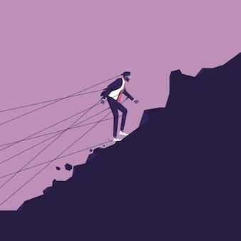Biznesmen próbuje odejść, ale jest powstrzymywany przez przymocowane do niego sznurki idź do celu