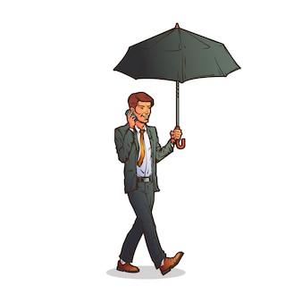Biznesmen rozmawia przez telefon z parasolem