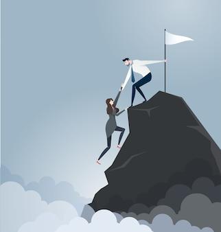 Biznesmen ściąga partnera na szczyt góry