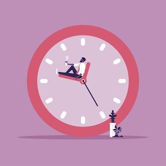 Biznesmen siedzący wygodnie i relaksujący się na strzałkach zegara przerwij zarządzanie czasem i czasem