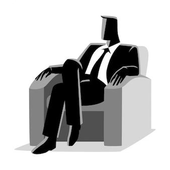 Biznesmen siedzi na kanapie