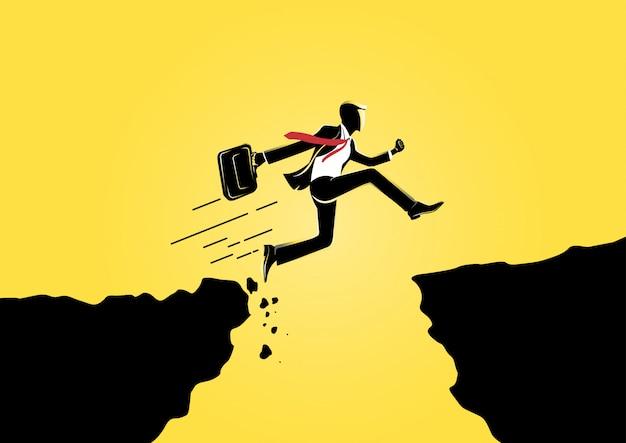 Biznesmen skoki przez szczelinę