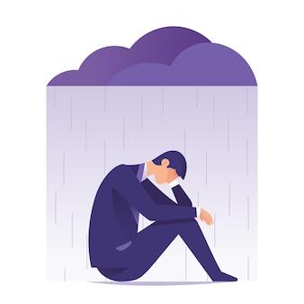 Biznesmen smutny i depresja siedzi pod deszczem i chmurą