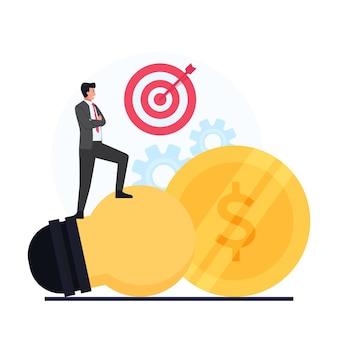 Biznesmen stoi nad wielką żarówką, widzi cel i monetę.