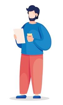 Biznesmen stoi z dokumentami i papierowym kubkiem w dłoniach.