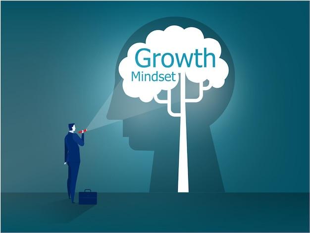 Biznesmen stoi z latarką do nastawienia na wzrost na głowie ludzkiej koncepcji wektora