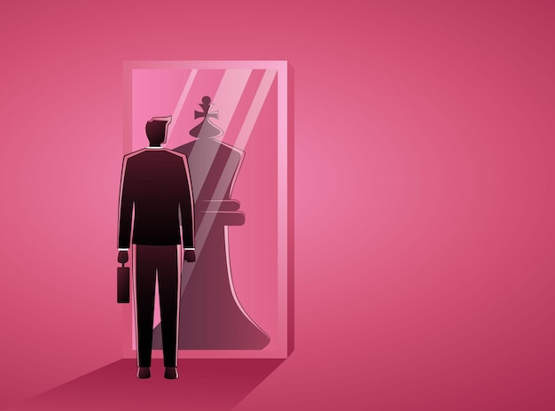Biznesmen stojąc przed lustrem, odzwierciedlając szachowego króla