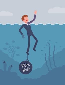 Biznesmen tonący przykuty łańcuchem do mediów społecznościowych