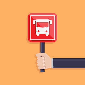 Biznesmen trzyma autobusowego szyldowego wektor