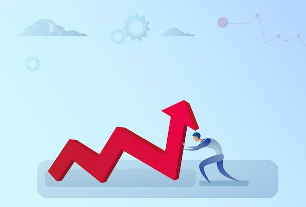Biznesmen trzyma strzałkę finansową w górę sukcesu rozwoju biznesu