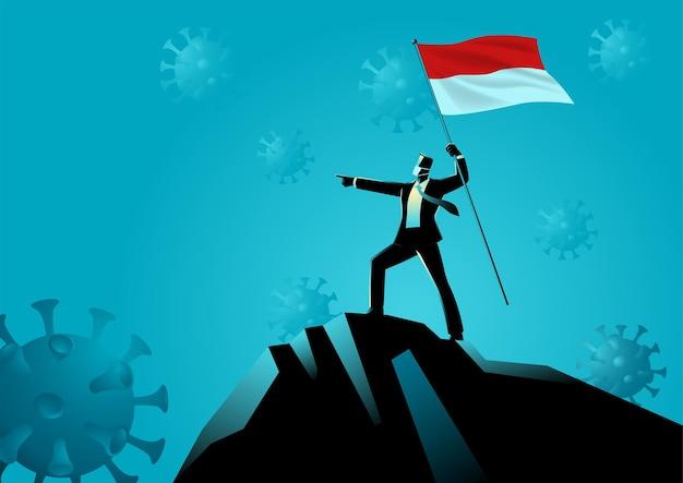 Biznesmen trzymając flagę indonezji na szczycie góry