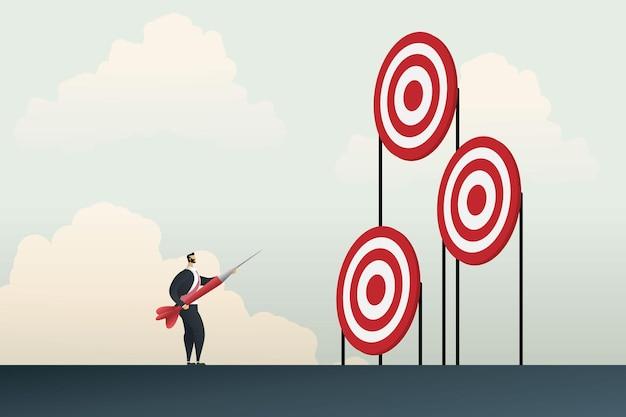 Biznesmen trzymający w ręku rzutki wybierający cele, które chcą sukcesu, ma na celu szansę na misję