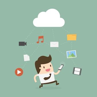 Biznesmen używa telefon komórkowego z obłoczną i medialną ikoną.