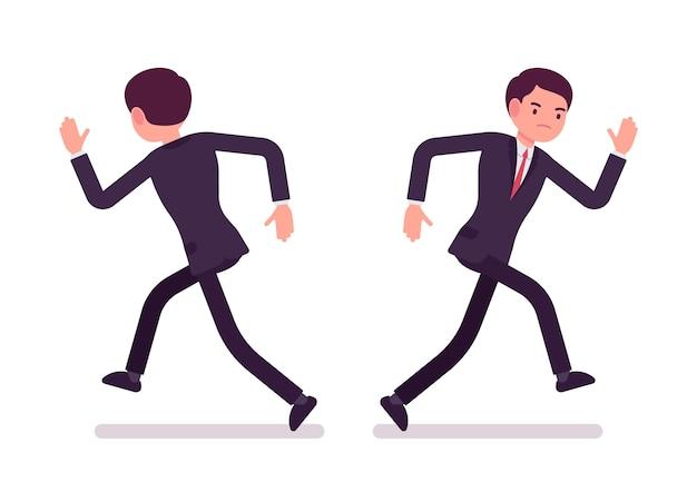 Biznesmen w wizytowym bieg, widok z przodu i tyłu