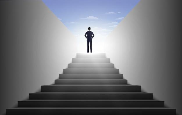 Biznesmen wchodzenie po schodach, koncepcja ambicje.