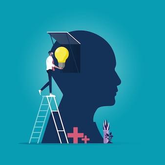 Biznesmen wkłada nowe pomysły w głowę, kreatywność i pomysł
