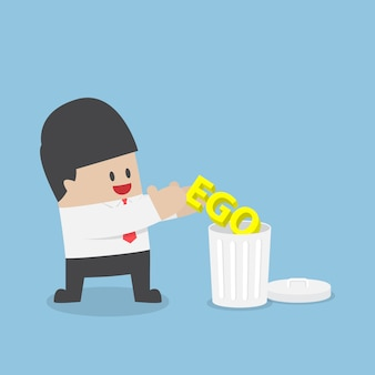 Biznesmen wyrzuca swoje ego do kosza