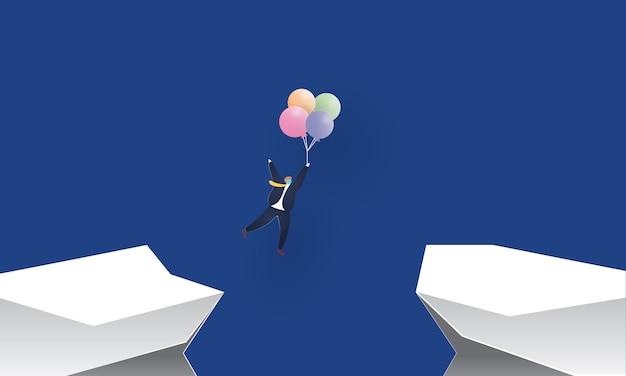 Biznesmen z balonami przez urwisko koncepcji inspiracji biznesowych, cięcia papieru