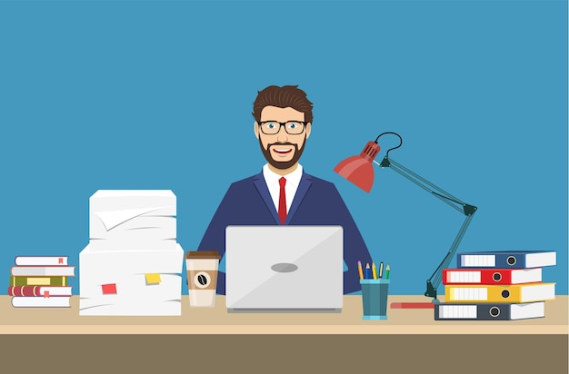 Biznesmen z biurowymi rzeczami