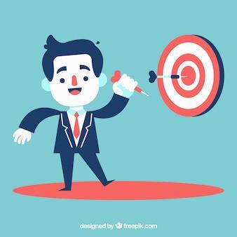 Biznesmen z celem i rzutki