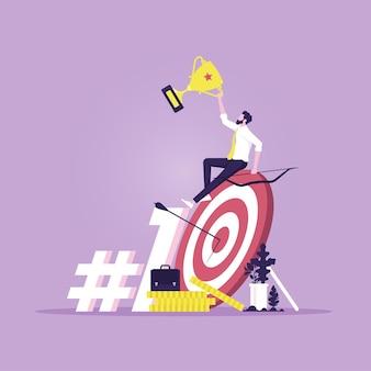 Biznesmen z celem trofeum i łucznictwa oraz koncepcja sukcesu biznesowego 1 słowo