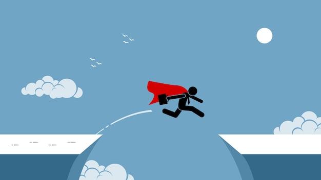 Biznesmen z czerwoną peleryną podejmuje ryzyko przeskakując przepaść.