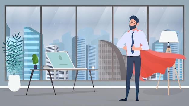 Biznesmen z czerwoną peleryną. szef jest w swoim biurze. koncepcja lidera, superbohatera. przedsiębiorca prezentuje klasę.