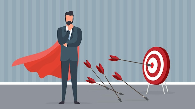 Biznesmen z czerwonym płaszczem uderza w cel.