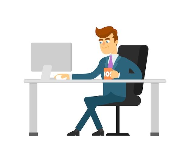 Biznesmen z filiżanką pracuje na komputerze