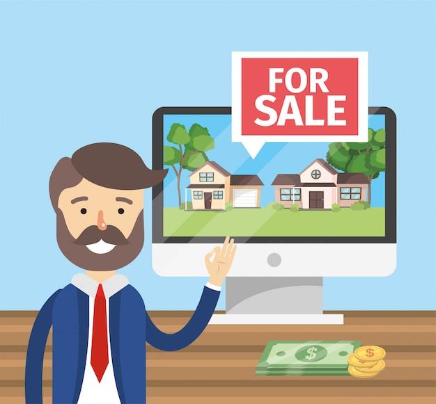 Biznesmen z komputerem do sprzedaży domów własności