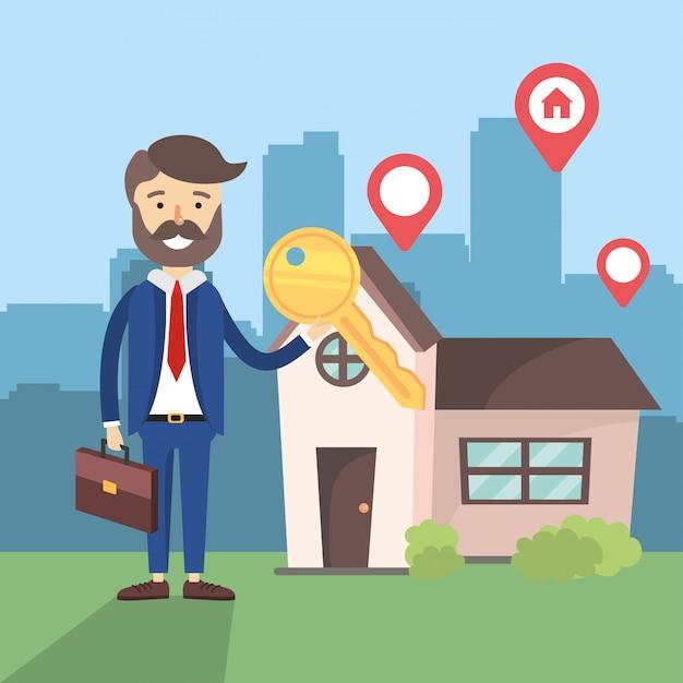 Biznesmen z lokalizacją sprzedaży kluczy i domu
