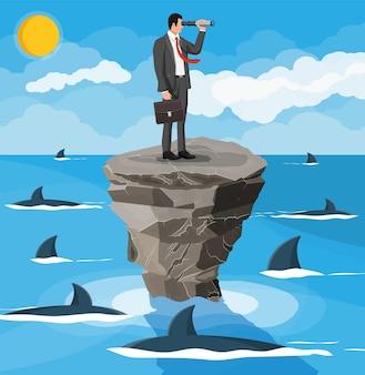 Biznesmen z lunetą na maleńkiej wyspie na morzu i w otoczeniu rekinów. przeszkoda w pracy, kryzys finansowy. zarządzanie ryzykiem. sukces, osiągnięcie, cel kariery wizja. płaska ilustracja wektorowa