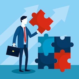Biznesmen z planem strategii puzzle i teczki