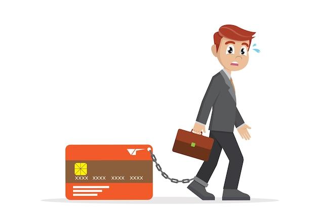 Biznesmen z stopą przykuty do banku karty kredytowej.