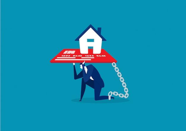 Biznesmen z stopą przykuwającą domowy kredytowej karty długu pojęcie