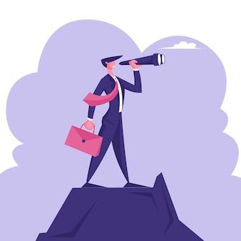 Biznesmen z teczką w ręku stoi na szczycie góry