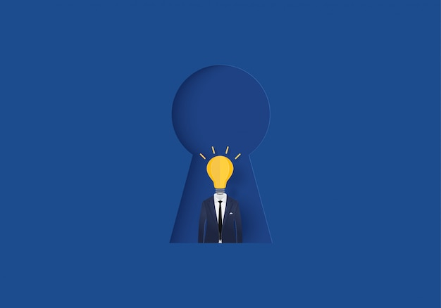 Biznesmen żarówka w keyhole pojęcia inspiraci biznesie