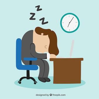 Biznesmen zasypia przy biurku