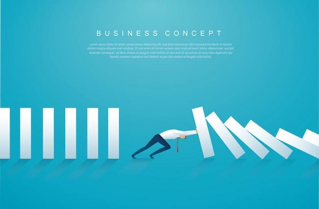 Biznesmen zatrzymuje efekt domina