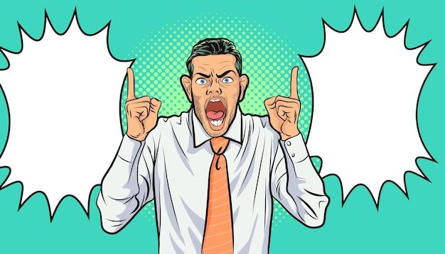 Biznesmen zły krzyczy wskazując ręką